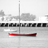Red Boat Black and White. Small red boat in the sea Royalty Free Stock Photo