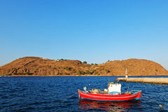 The red boat in the blue lagoon. Royalty Free Stock Photo
