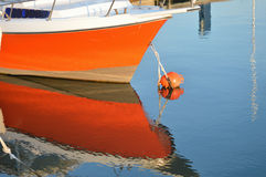 Red Boat. Bright red boat reflecting in water royalty free stock photos