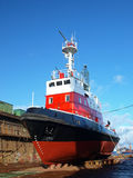 Red boat in dock Stock Photography