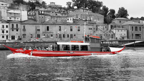 Red boat on douro river in porto port. Red and greyscale Stock Images