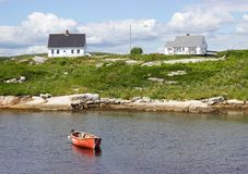 Red boat in harbour, houses, Peggy's Cove, Nova Scotia, Canada Stock Photo
