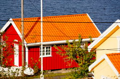 Red boat house near fjord Kragero, Portor, Norway. Atumn in Norway, red boat wood house and vilage view of a Portor by the fjord in Portor vilage, Kragero stock images