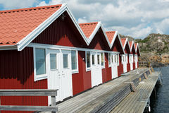 Red boat houses at the Sea. A row of red boat houses at the Swedish west coast Royalty Free Stock Photos