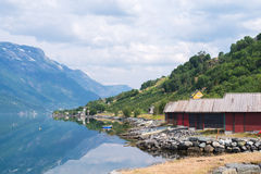 Red boat-houses at th shore of fjord Royalty Free Stock Photos