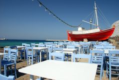The red boat on the island of Mykonos. The red boat with octopus on the island of Mykonos stock photos