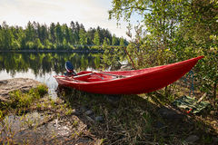 Red boat on the lake shore Royalty Free Stock Photos