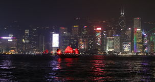 Red boat light show. Hong Kong, China - December 8, 2016: City skyline light show with Aqua Luna red-sail junk boats. with famous skyscrapers Bank of China stock video footage