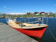 Red boat, Lithuania Stock Images