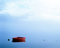Red Boat on Loch.(scotland). Stock Image