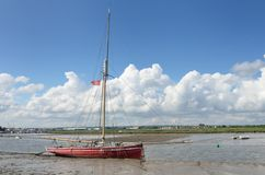 Red boat at low tide Royalty Free Stock Images