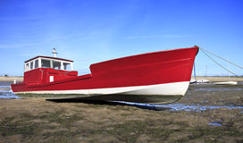 Red boat at low tide in Lege Cap Ferret Stock Photo
