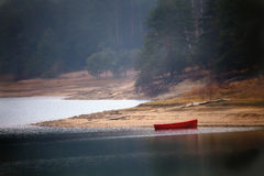 Red boat in misty day Stock Images