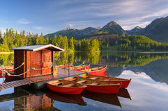 Red boat in a mountain lake. Beautiful red boat in a mountain lake Strbske Pleso, Slovakia, Europe royalty free stock photography