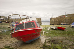 Red boat in Mousehole harbour Royalty Free Stock Photo