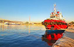 Red boat at the new mole of Drapetsona royalty free stock images