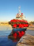 Red boat at the new mole of Drapetsona Stock Photos