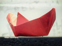 Red boat. Red paper boat on a street in Belgrade Royalty Free Stock Photos