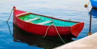 Red boat. Picture of red, wooden boat in reflective water. Photo was taken in Malta Royalty Free Stock Photography