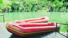Red inflatable boat and the green waters of Formoso river. Red boat on the river. River with green water, beautiful nature landscape. Red inflatable boat for Royalty Free Stock Photo