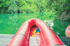 Red inflatable boat and the green waters of Formoso river. Red boat on the river. River with green water, beautiful nature landscape. Red inflatable boat for Stock Photo