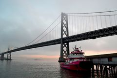 Red Boat and the San Francisco Oakland Bay Bridge. This photo was taken last January 9, 2019, and it was a very cold and very foggy morning stock images