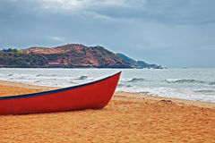 Red boat on a sandy beach Royalty Free Stock Photo
