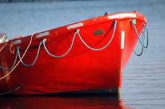 Red boat in the sea Stock Image