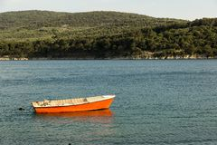 Red boat at the sea. Red boat at the Adriatic sea in the summer time stock photo