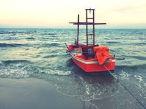 Red boat. On the seashore Royalty Free Stock Photo