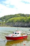 red boat in a small Welsh marina Royalty Free Stock Images