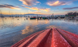 Red Boat and Sunrise Stock Images