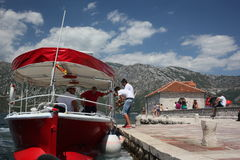 Red Boat taxis in Montenegro. Royalty Free Stock Photo