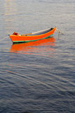Red boat on water Stock Photo