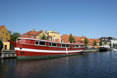 Red boat on water canal Royalty Free Stock Photo