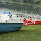 Red boat with white sign. Surf rescue, blue river in background Royalty Free Stock Photo