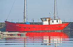 Red boat with white wheelhouse in Harbor. Royalty Free Stock Image
