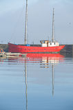 Red boat with white wheelhouse in Harbor. Royalty Free Stock Images