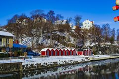 Red boathouses at the small marina royalty free stock images