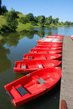 Red boats. In a row at landing stage Stock Photography