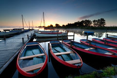 Red boats on harbor at sunrise Royalty Free Stock Photo