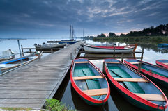 Red boats on lake harbor Stock Photo