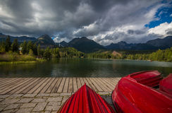 Red boats. Photo of Strbske Pleso was taken in High Tatras national park, Slovakia stock photo