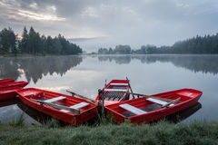 Red boats on pond Royalty Free Stock Photography