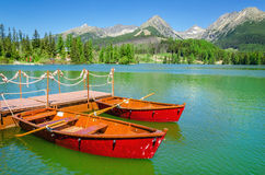 Red boats and Tatra Mountains high peaks, Slovakia Royalty Free Stock Images