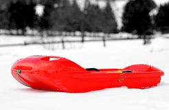 Red bob made of plastic on white snow Royalty Free Stock Image