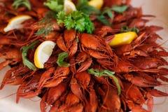 Red boiled crawfish with lemon close up Stock Photo