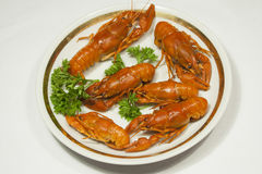Red boiled crawfish on a plate with seasoning. On a white background Stock Photo