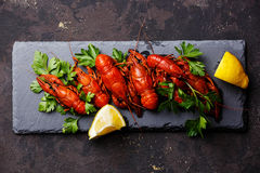 Red boiled crayfish with lemon Royalty Free Stock Photography