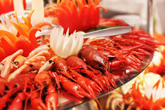 Red boiled lobster, crabs and crawfish on a plate Royalty Free Stock Image
